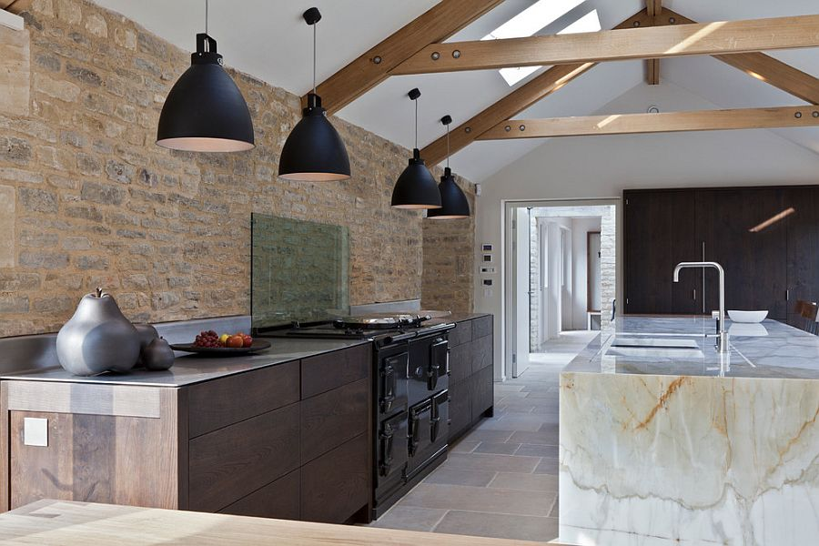 Exposed original stonework of contemporary kitchen inside an old barn turned into modern home [Design: Studio Mark Ruthven]