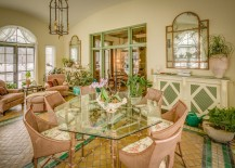 Exquisite Mediterranean sunroom with a dash of rose and green
