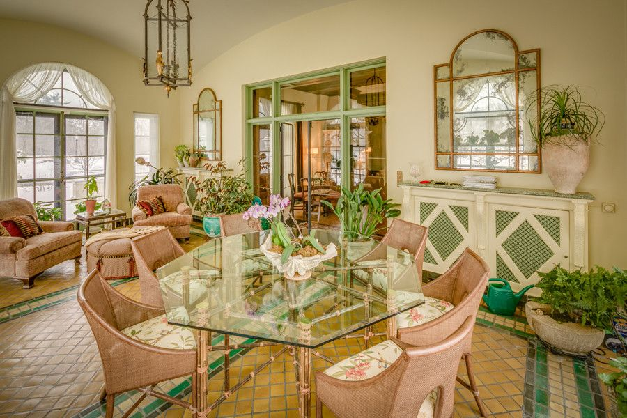 Exquisite Mediterranean sunroom with a dash of rose and green [Photography: David M Ward]