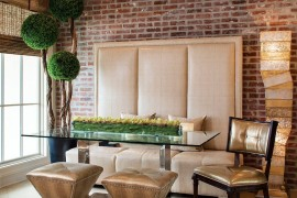 Exquisite contemporary dining room dazzles with custom banquette, decor and a pinch of greenery