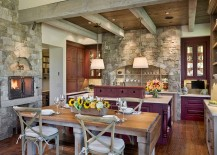 Exquisite-eat-in-kitchen-with-fireplace-purple-cabinets-and-stone-walls-217x155