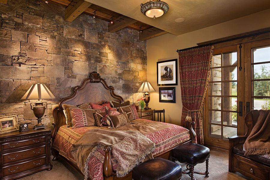 Exquisite rustic bedroom with stone wall has a masculine vibe [Design: Locati Architects]