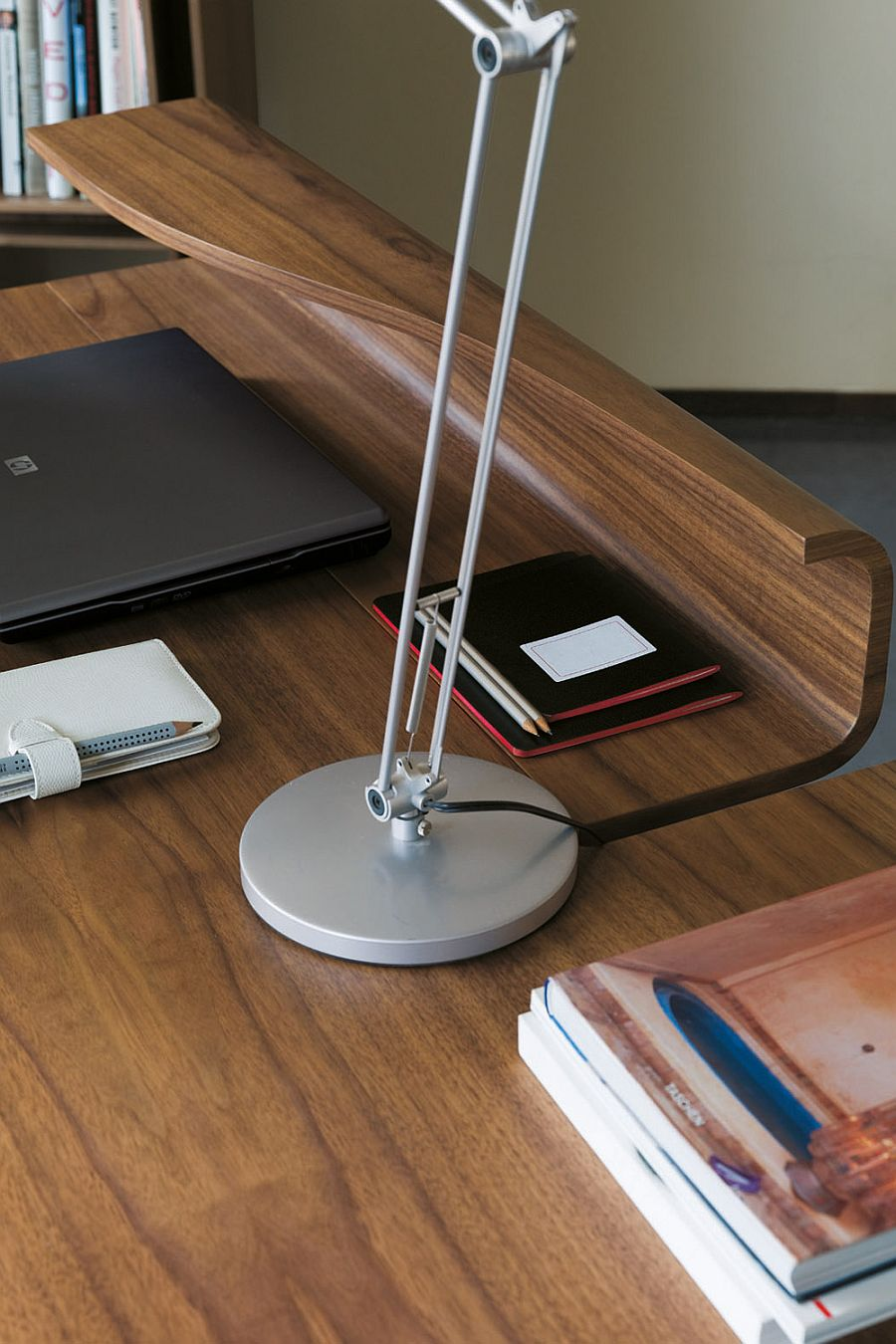 Exqusite design of office desk in walnut keeps things classic and simple