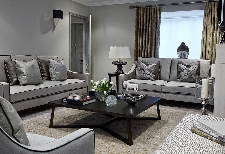 Fabulous living room in gray with a black coffee table [Design: Boscolo Interior Design]