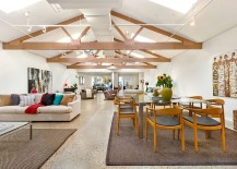 Fabulous use of skylights ushers in a stream of natural light into the revamped warehouse home