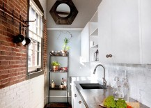 Fabulous way of creating different visual sections in the kitchen with a brick wall