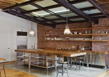 False ceiling with a light source above it creates the impression of a skylight in the industrial kitchen