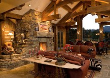 Family room with glass walls and stone fireplace at its heart