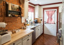 Farmhouse kitchen with antique shelf and brick wall backdrop