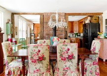 Farmhouse style dining room with brick wall feature