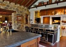 Farmhouse-style-kitchen-with-stone-wall-and-La-Cornue-Range-217x155