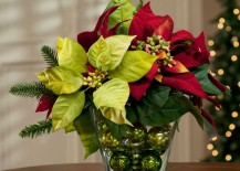 Faux poinsettia arrangement in glass vase with Christmas ball ornaments 217x155 17 Lovely Ways to Display Poinsettias for the Holidays
