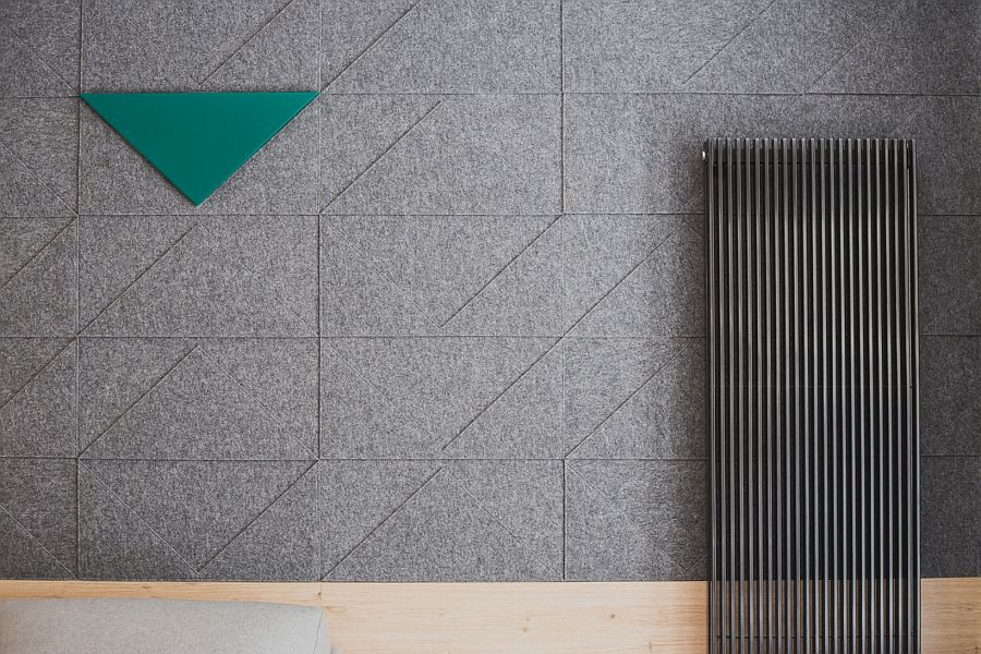 Felt design on the walls gives textural beauty to the contemporary interior