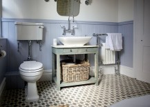 Floor tiles add pattern to the small bathroom in neutral hues