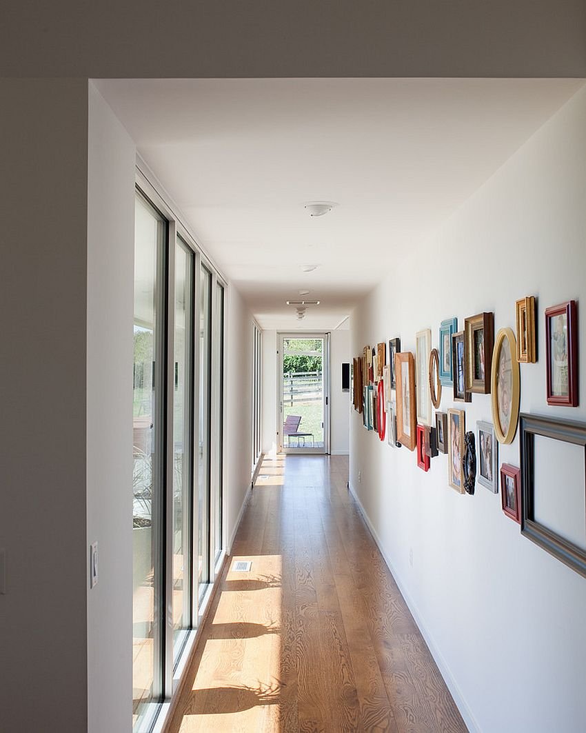 ... Gallery Wall Is Filled With Framed Pictures And A Few Empty Frames [ Design: Hufft
