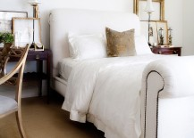 Gold-frames-bring-sparkle-and-symmetry-to-this-all-white-bedroom-217x155