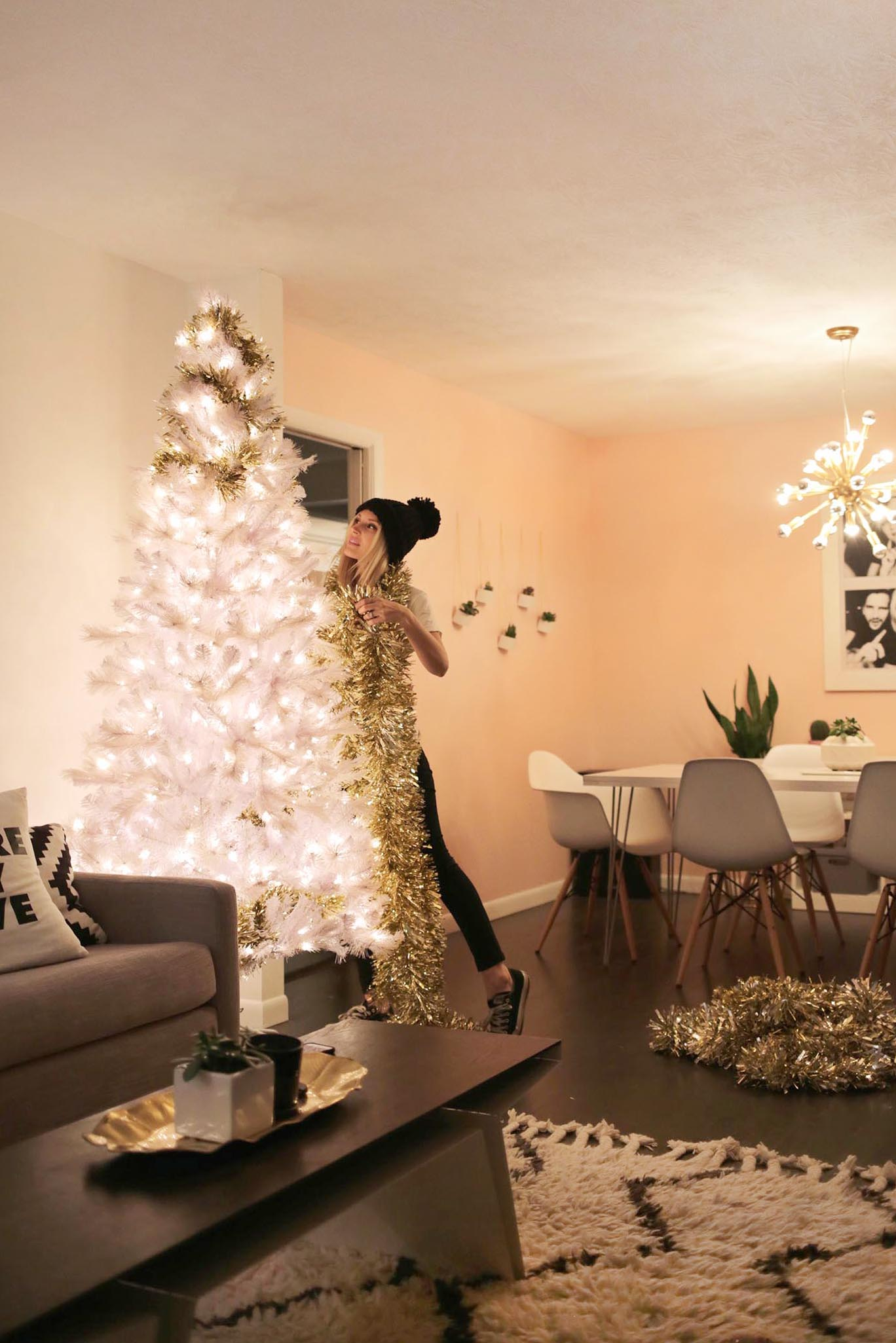 Gold garland and tree decorating featured at The Band Wife