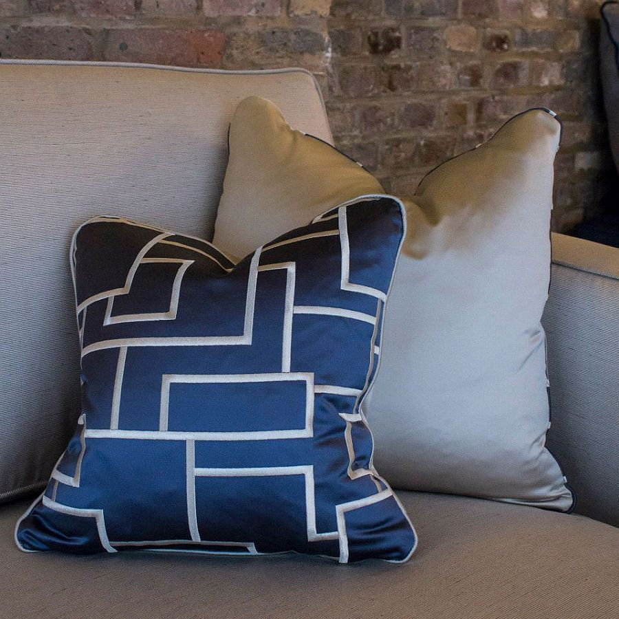 Gorgeous accent pillows add color to the London apartment