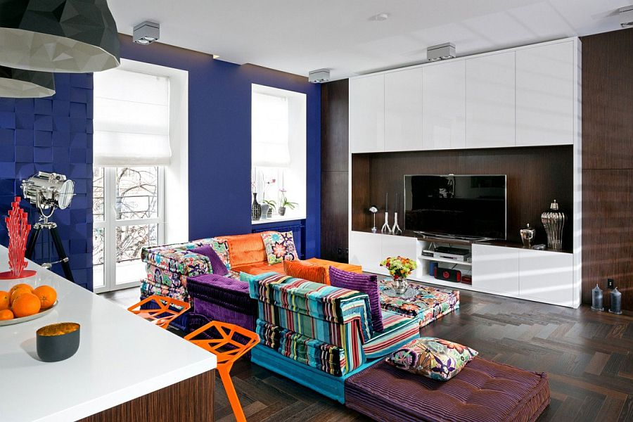 Gorgeous and colorful modular sofa by Roche Bobois sits at the heart of the home theatre guest room Unraveling a Secret: Small Apartment in Kiev Amazes with Cleverly Concealed Rooms