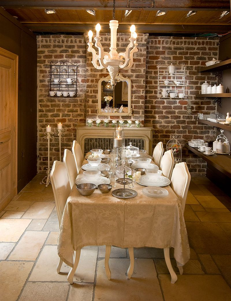 gorgeous dining room with tiled flooring and brick walls brings classic charm to setting