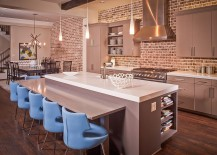 Gorgeous gray cabinets and kitchen island in kitchen with beautiful brick wall