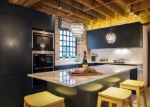 Gorgeous-pendant-lights-add-to-the-glitter-of-the-bluish-gray-kitchen-with-brick-wall-217x155
