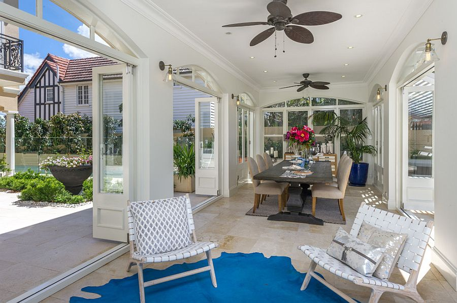 Gorgeous sunroom in white with a hint of blue [Design: Danka Interiors]