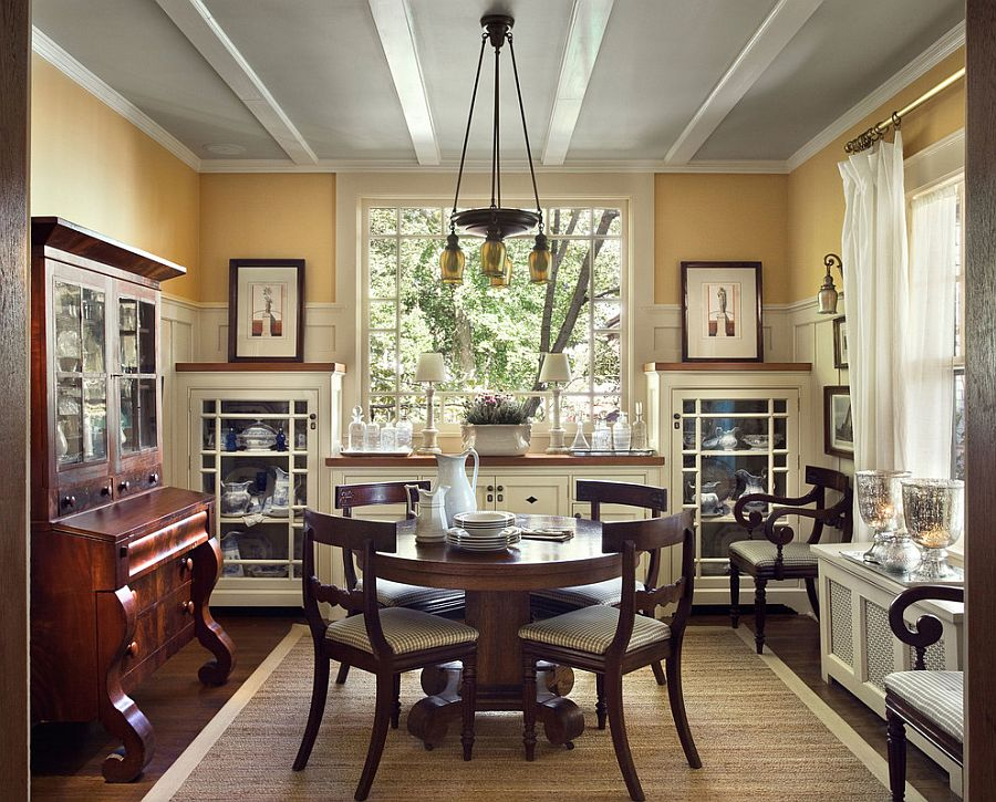 Gray ceiling gives a unique look to the transitional dining room [From: Francis Dzikowski Photography]