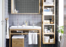 Gray-tiled-bathroom-with-wood-furniture-and-shelving-unit-attached-to-wall-217x155