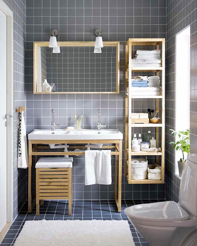 Gray Tiled Bathroom With Wood Furniture And Shelving Unit Attached To Wall