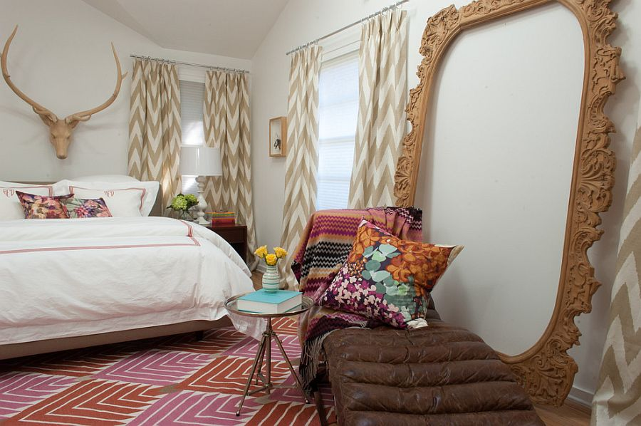 Hand-carved wooden frame adds visual height to the eclectic bedroom [Design: Angela Flournoy]