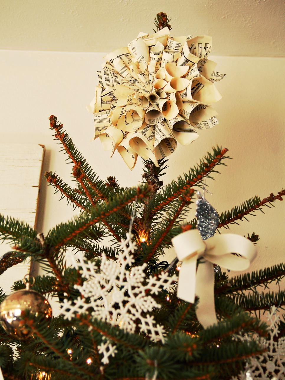 View in gallery Handmade tree topper made from old music sheets