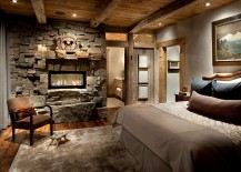 Harlowton-stone-fireplace-wall-with-a-custom-mantle-and-modern-fireplace-217x155