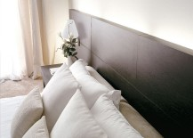 Headboard fixed in natural oak also provides for sleek side tables