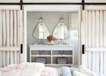Herringbone-pattern-backsplash-in-bathroom-with-sliding-barn-doors-217x155