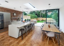 Herringbone pattren flooring and brick wall backsplash in the modern kitchen