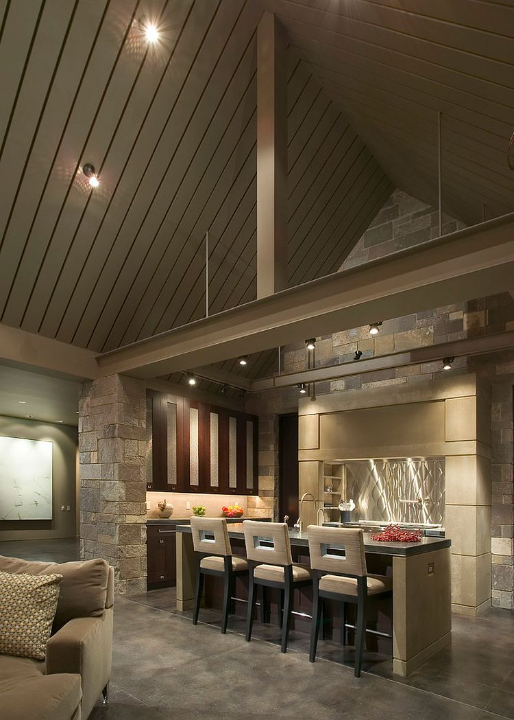 Hue of the natural stone blends in with the visual of the gray vaulted ceiling [Design: Stuart Silk Architects]
