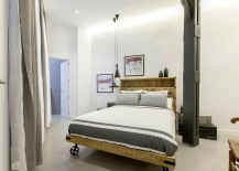 Industrial-bedroom-with-Tom-Dixon-pendant-lighting-and-a-bed-on-wheels-217x155