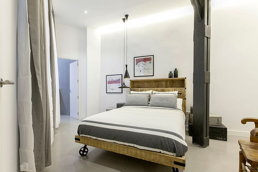 Industrial bedroom with Tom Dixon pendant lighting and a bed on wheels [From: Lupe Clemente Fotografia]