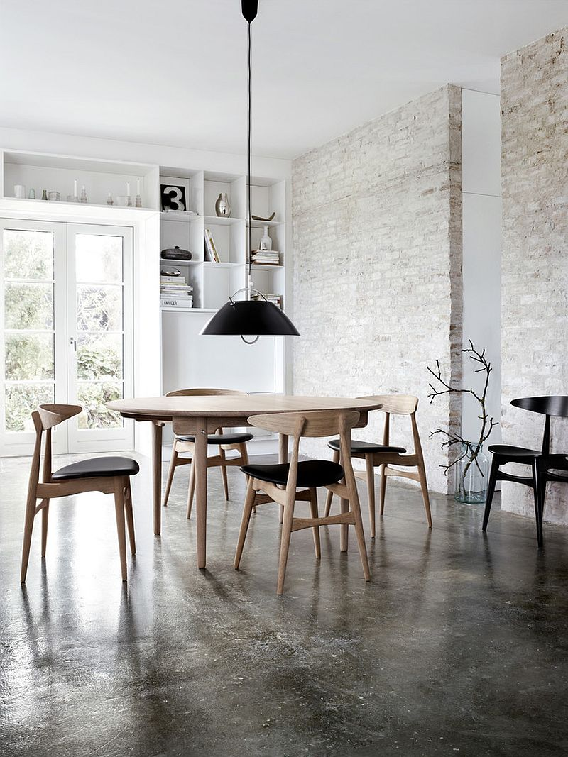 Industrial dining room with a fabulous finish for the exposed brick wall [Design: SUITE New York]