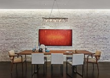 Industrial-minimal dining room with a whitewashed brick wall backdrop