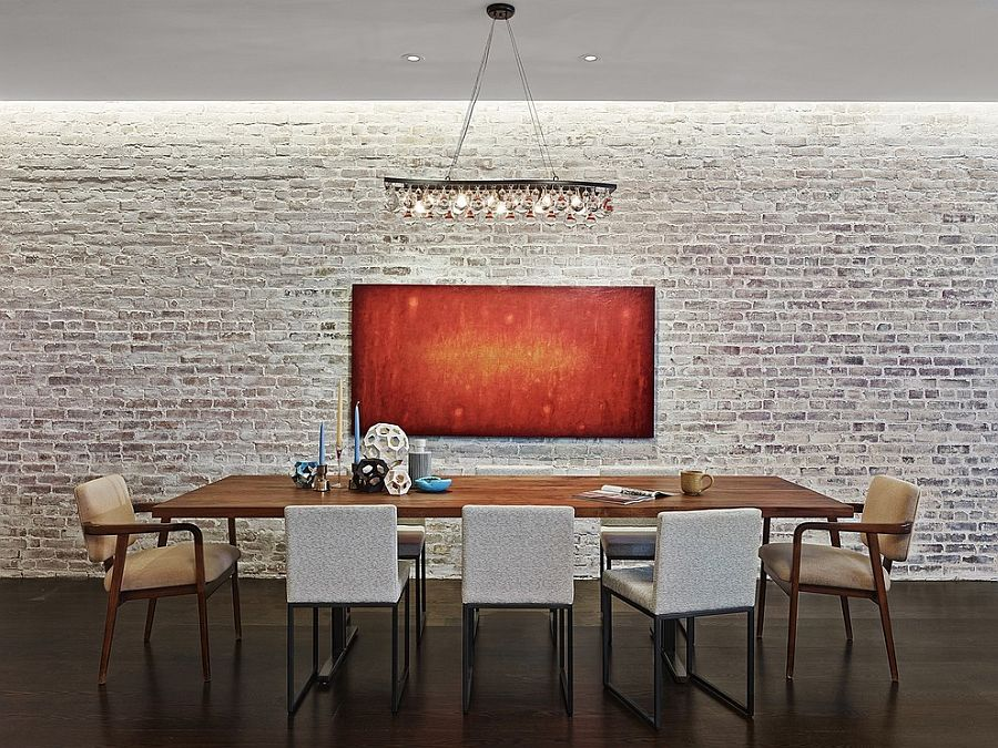 Industrial-minimal dining room with a whitewashed brick wall backdrop [Design: Tamara Eaton Design]