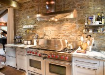 Ingenious industrial kitchen with stone wall and marble countertops