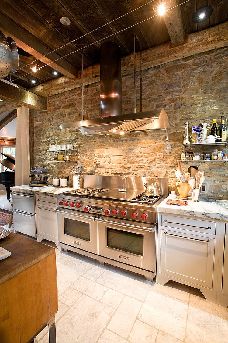 ... Ingenious industrial kitchen with stone wall and marble countertops  [Design: Jarrett Design]