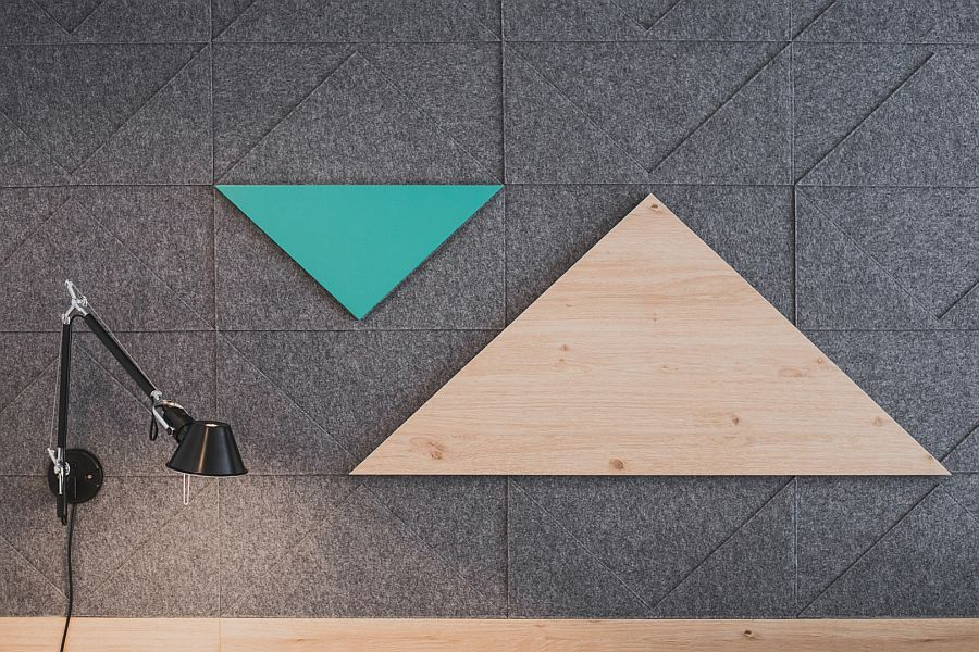Innovative way to add pattern to the living room with geometric shapes and a felt backdrop