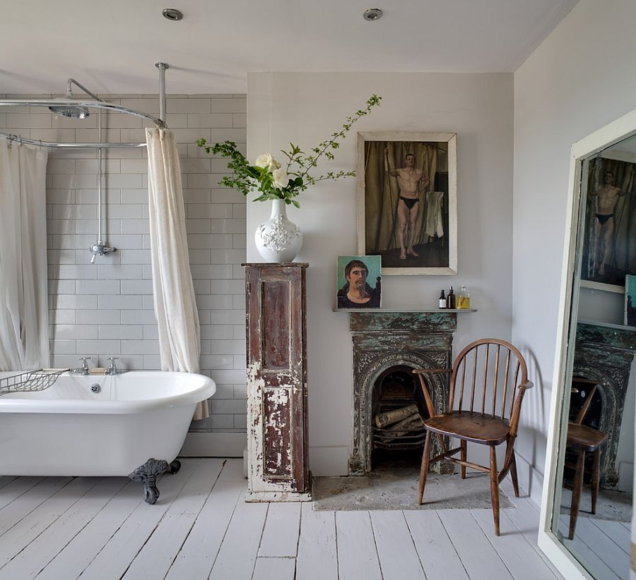 Interesting art work and clawfoot bathtub for the shabby chic bathroom