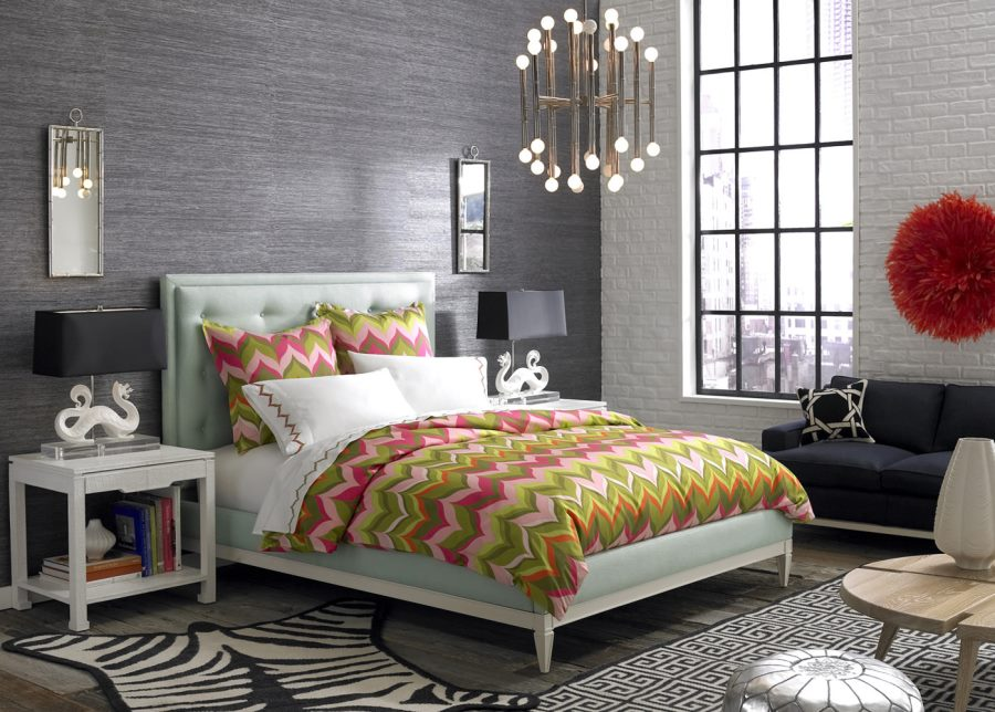Jonathan Adler bed with a tufted headboard