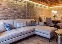 L shaped couch and rustic dining table for the small London apartment 217x155 Brick Beauty: Chic Converted Warehouse Apartment in Shad Thames