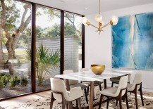 Large glass windows open up the contemporary dining room to the view outside