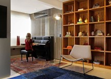 Large-wooden-shelf-in-the-living-area-and-a-piano-in-the-corner-217x155